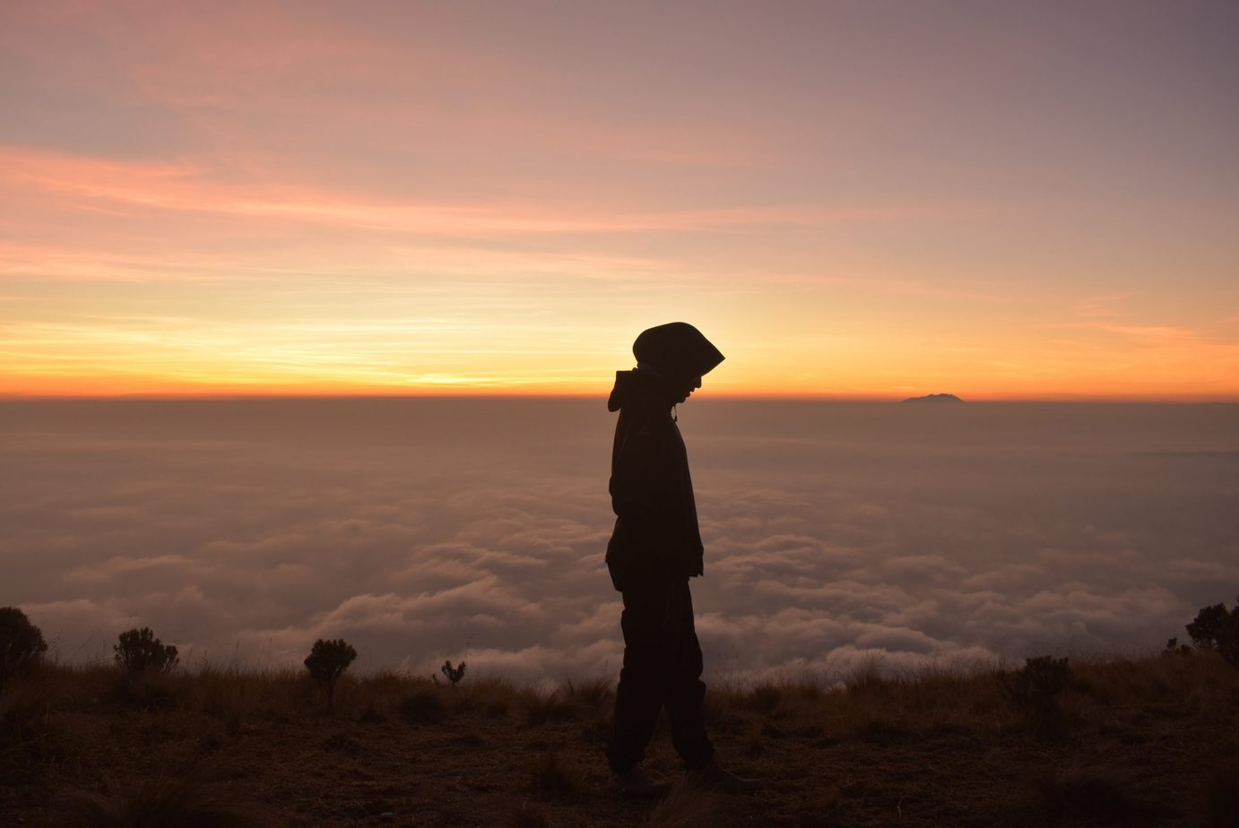 Woman in hijab above the clouds
